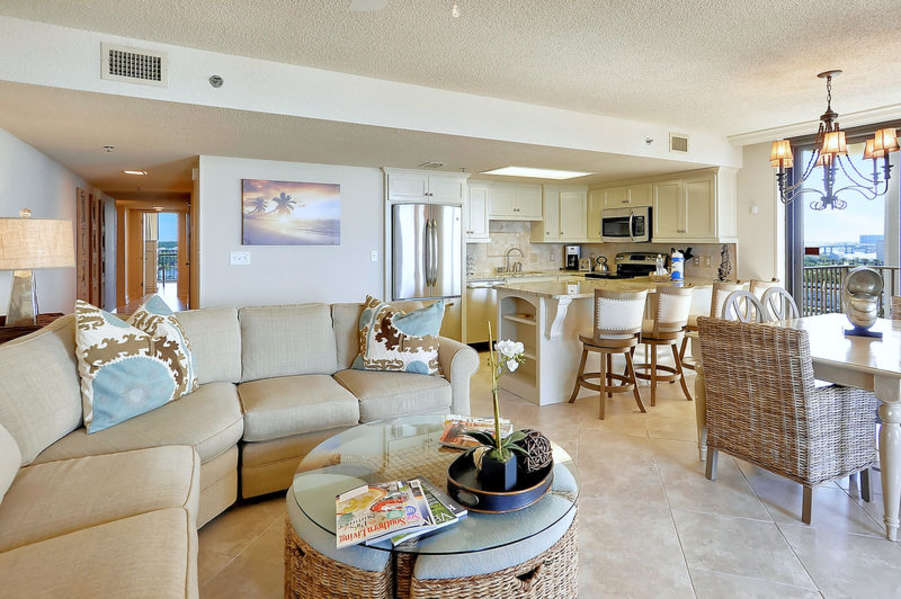 Spacious Living and Dining Areas with Balcony Access and Sleeper Sofa