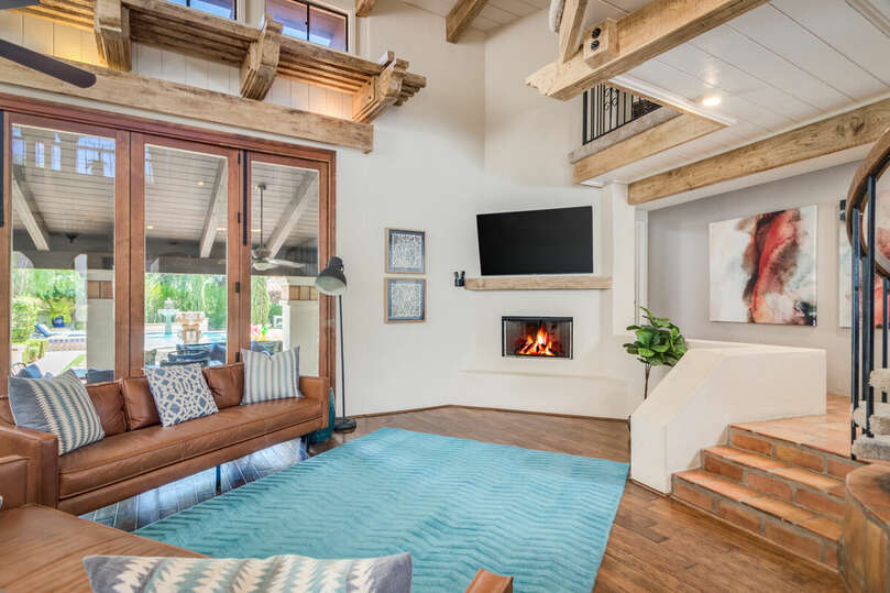 Open living area with fireplace and loft.