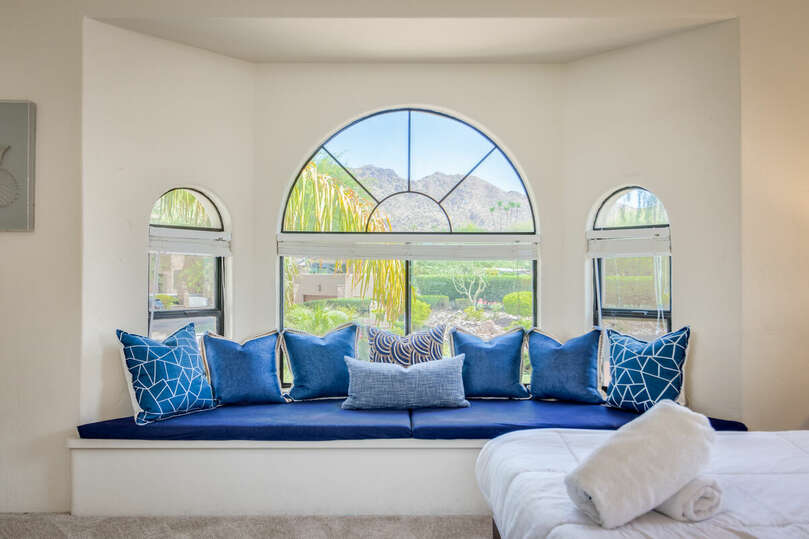 Large upstairs bedroom with window seat and mountain views.