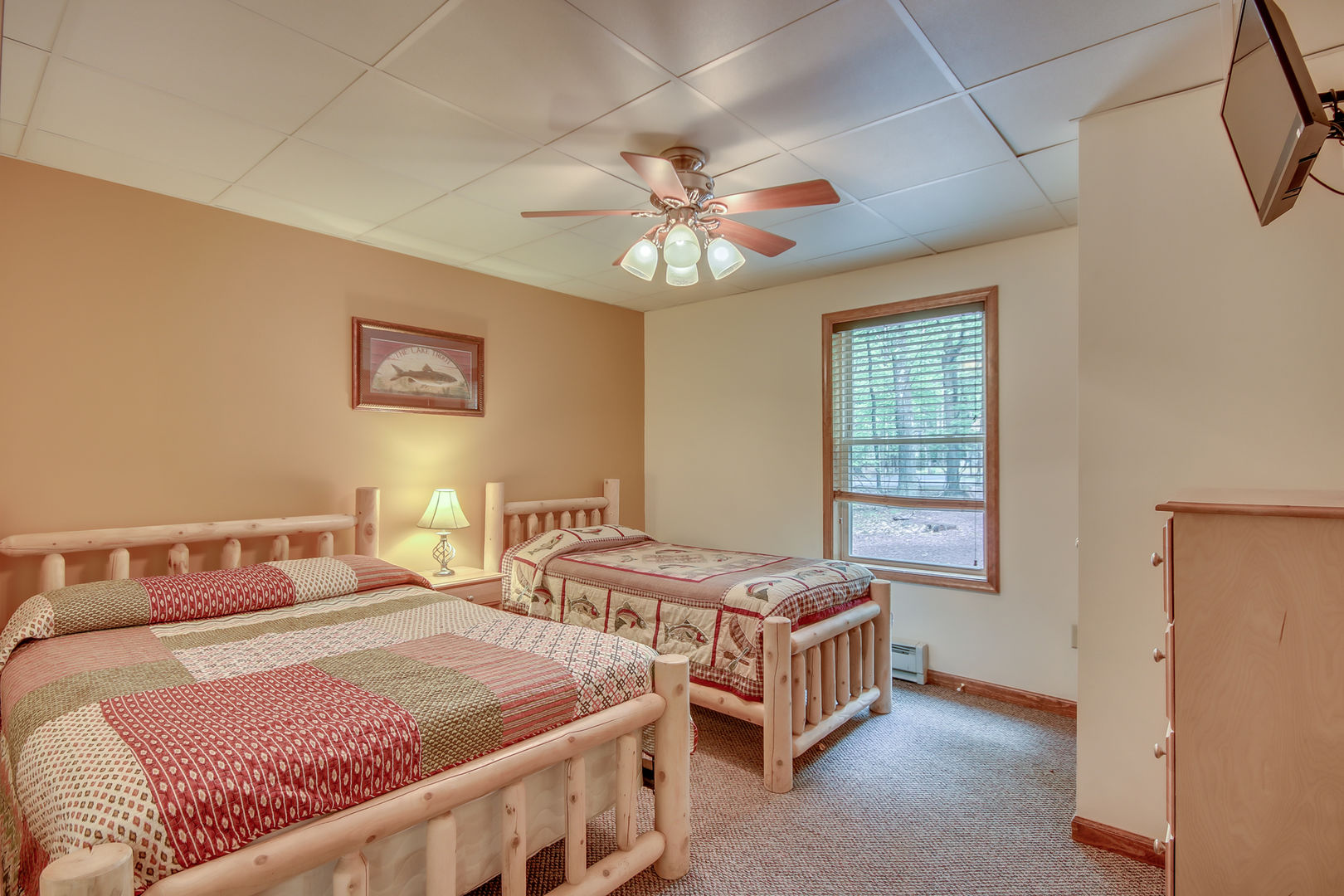 Two Beds, One Dresser, and TV in One of Our Bedrooms.