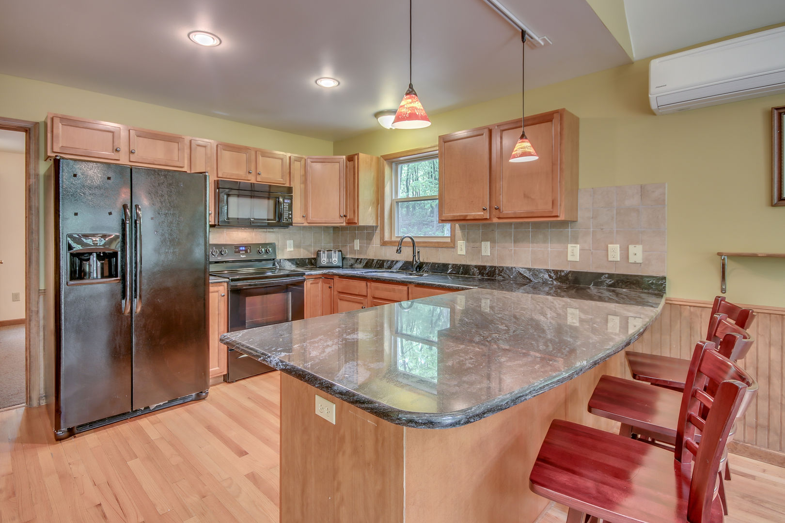 Spacious Kitchen in Our Pocono Mountain Lakefront Rental with Island and Chairs.