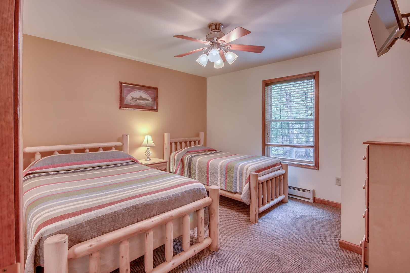 A Photo of a Bedroom in Our Pocono Mountain Lakefront Rental with Two Beds.