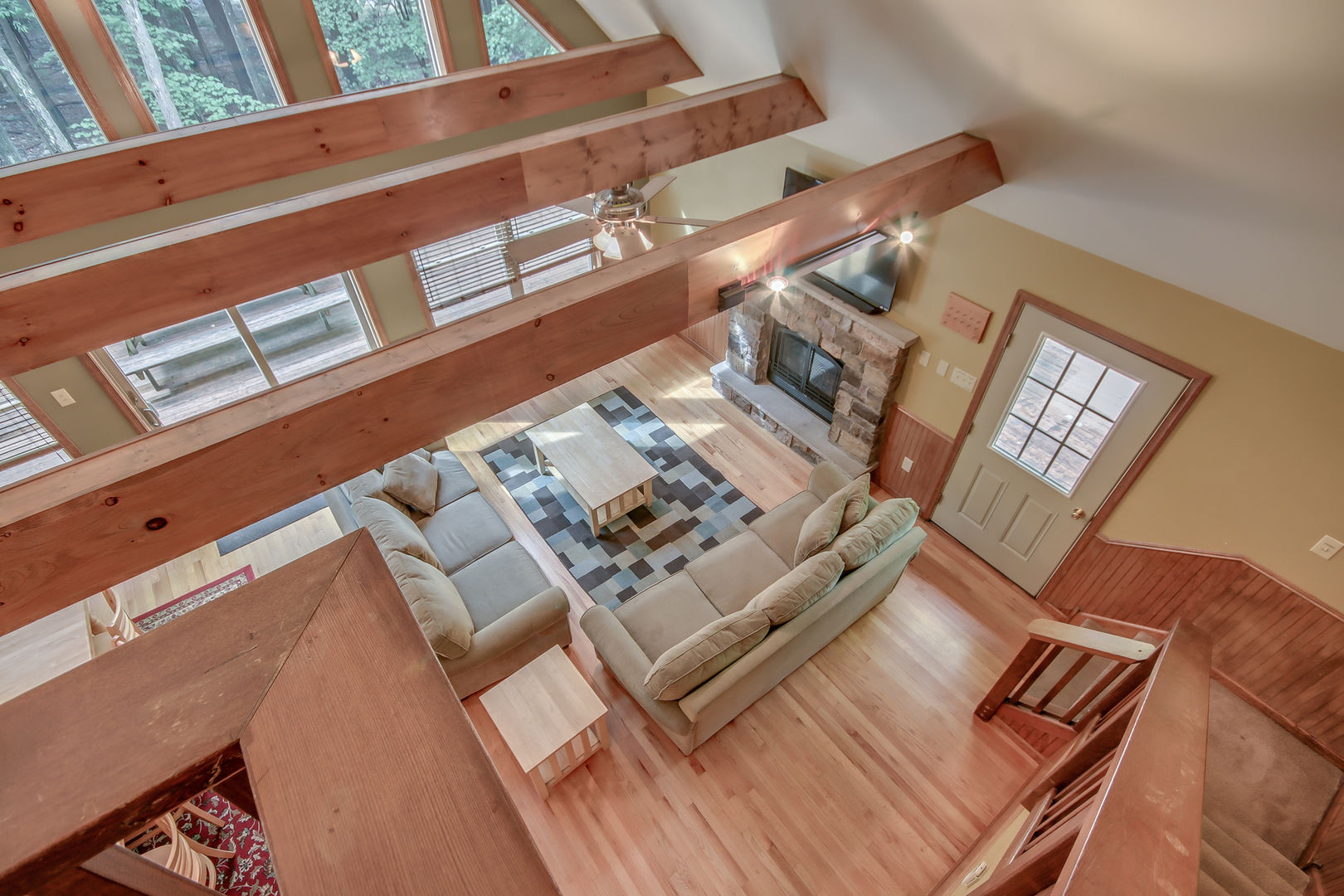 An Image From Upstairs Facing the Living Room.