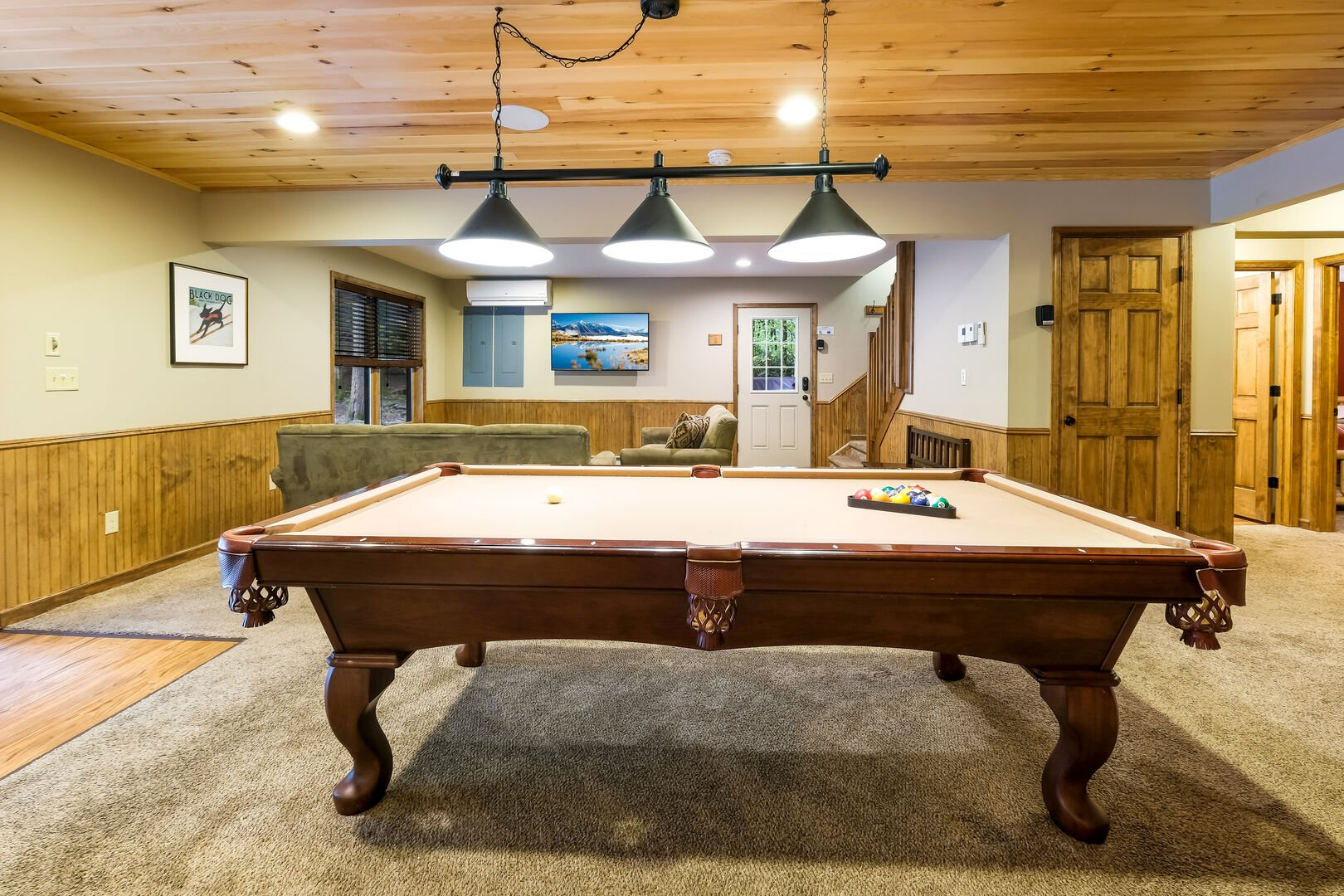 Pool table in the game room of this luxurious Poconos vacation rental.