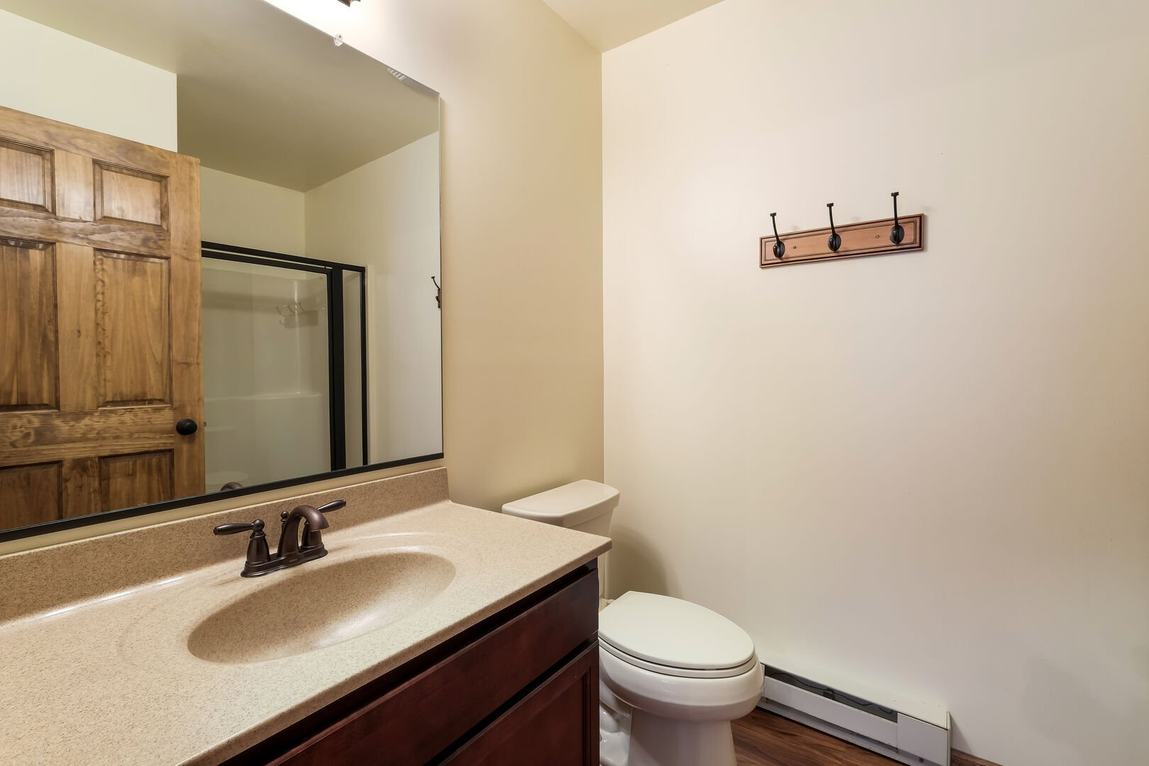 Toilet, sink, and mirror in a rental bathroom.