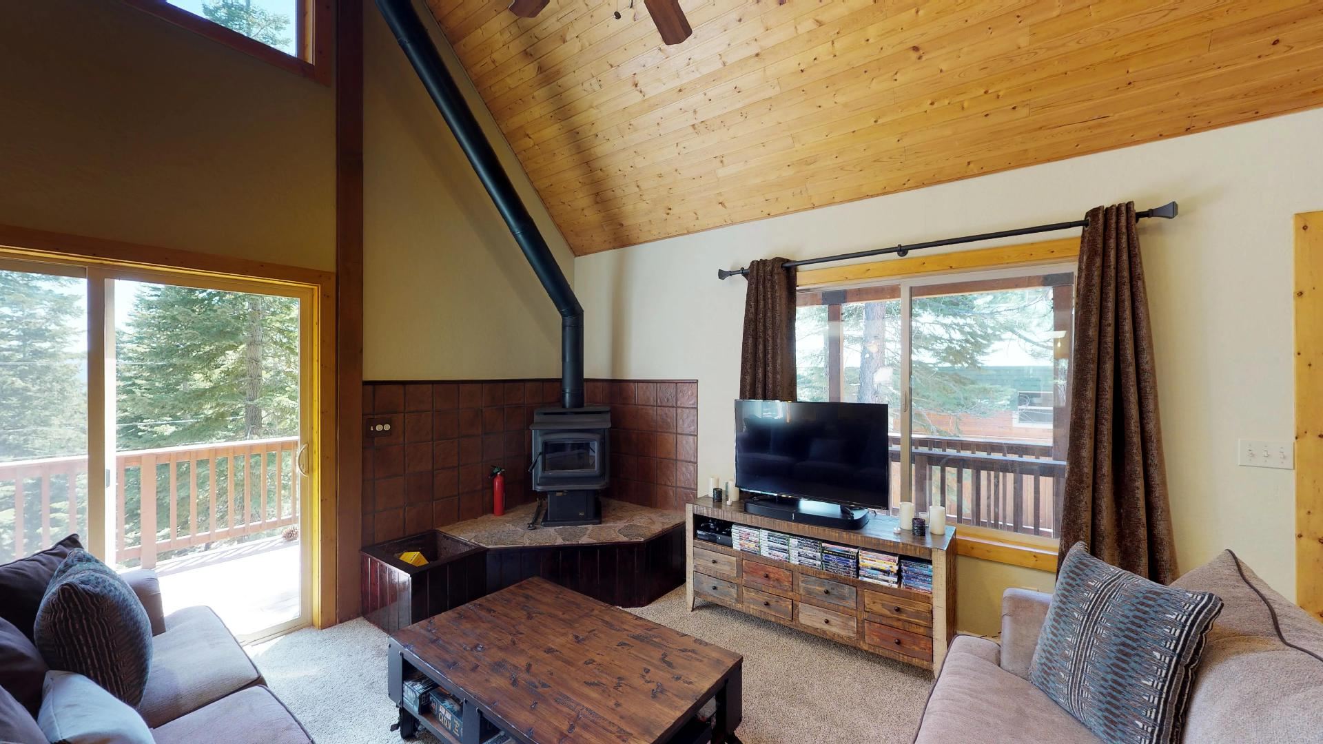 Living Area Features a Fireplace and Flat Screen TV