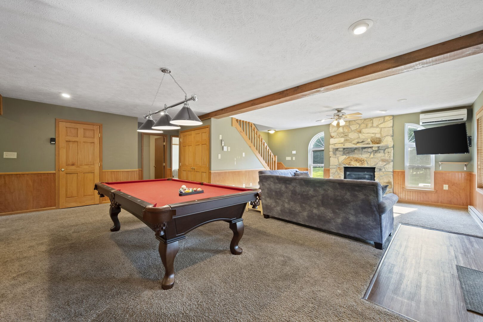 View of Game Room with Pool Table and Fireplace