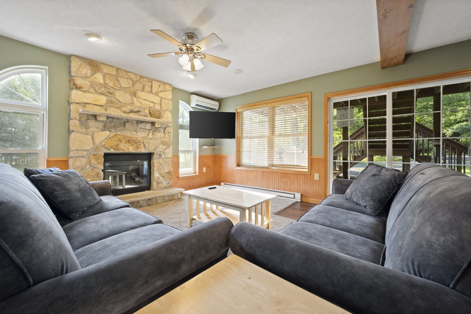 Twin couches next to fireplace