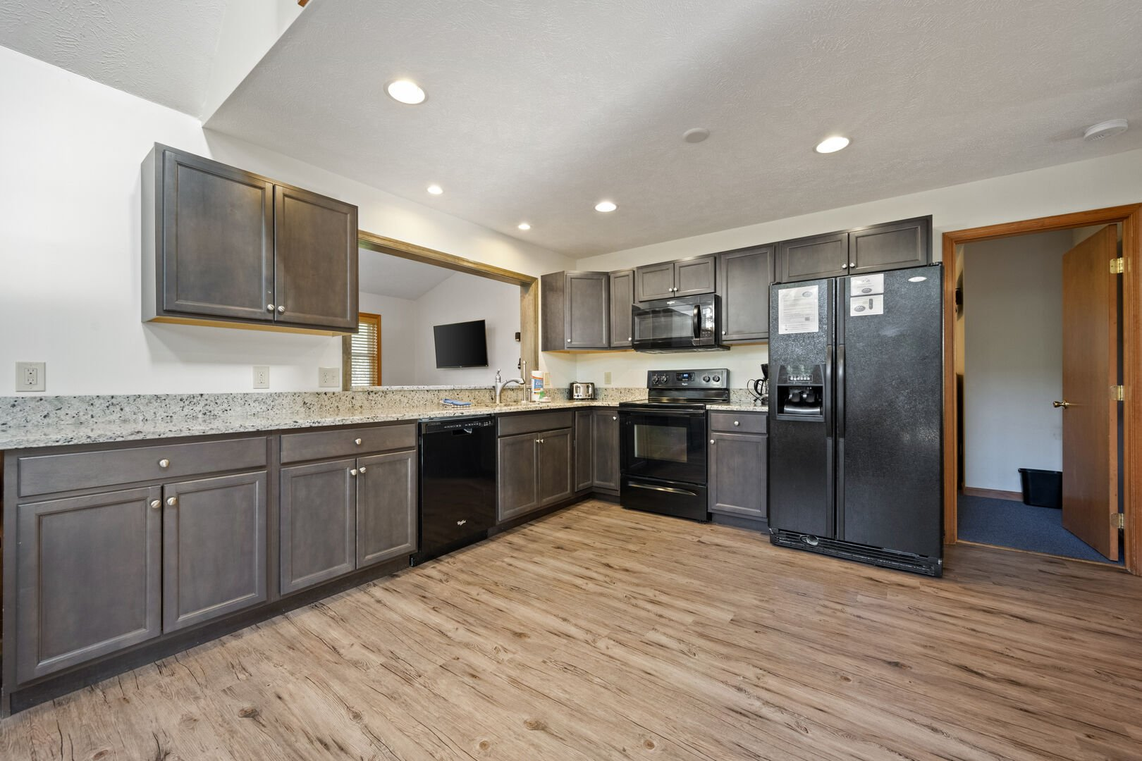 Kitchen area with refrigerator and oven