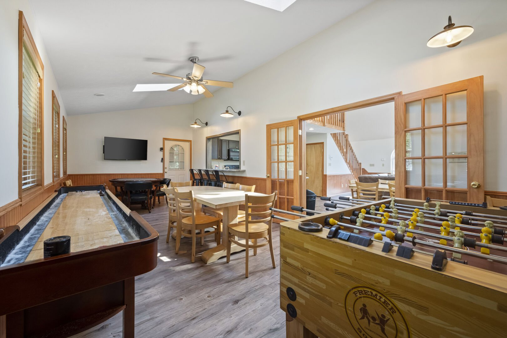Shuffleboard table and nearby foosball table
