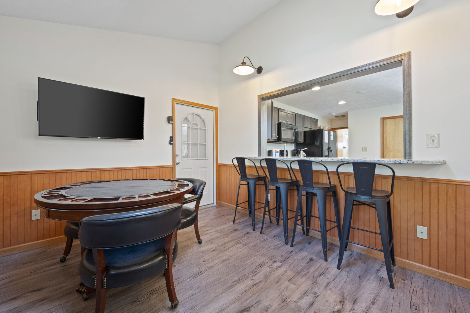 Poker table and nearby bar seating