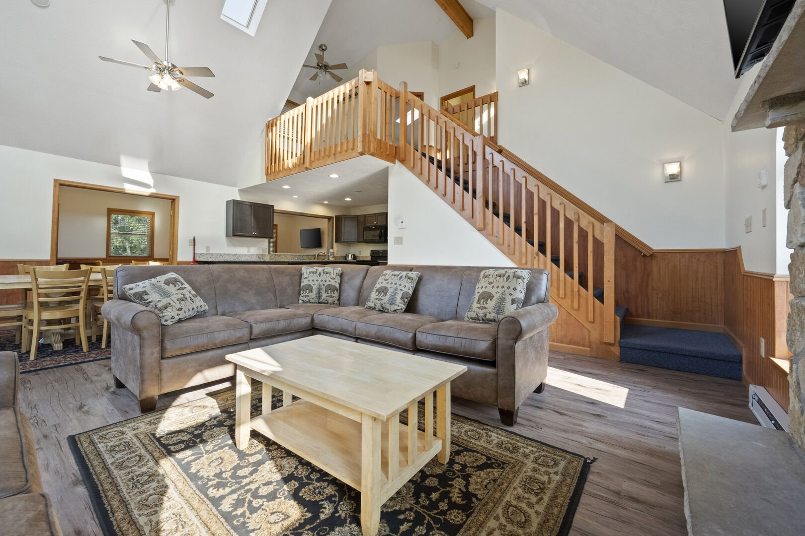 Couch in living room with nearby staircase.