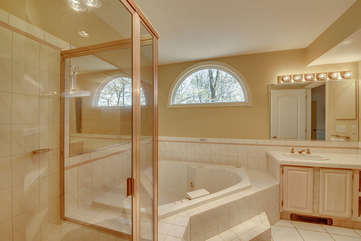 bathtub and sink in cream bathroom