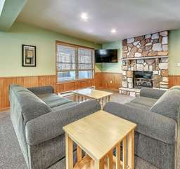 Couches, Fireplace, and Flat Screen TV in our Poconos Lodge Rental