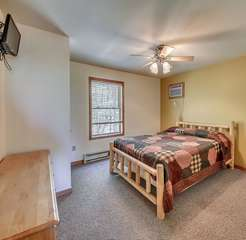 One of the Bedrooms with Bed and Flat Screen TV in the Coyote Vacation Rental