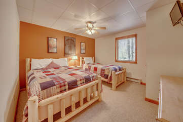 Photo of Bedroom with an Orange Accent Wall and Two Beds.