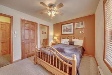 Large Wooden Bed and Closet in Bedroom of Our Pocono Lakefront Rental.