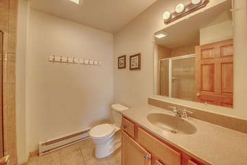 A Photo of Sink, Toilet, Shower in Bathroom.