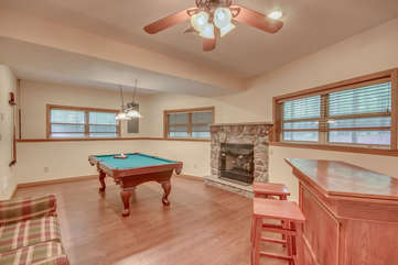 A Game Room with Pool Table Located Within Our Vacation Rental in the Poconos by Lake.