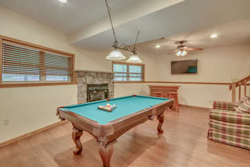 A Pool Table and Fireplace in the Game Room of Our Vacation Rental in the Poconos by Lake.