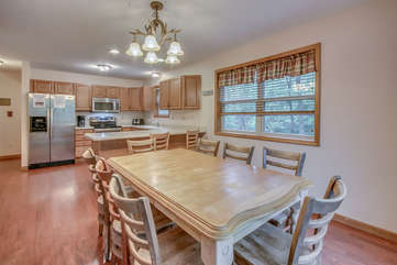 A Kitchen Table with Seven Chairs in Our Vacation Rental in the Poconos by Lake.