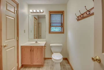 A Bathroom Image Showcasing Sink and Toilet.