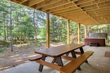 Picnic Table and Hot Tub Outside our Poconos Vacation Rental Home