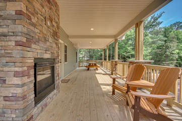Wraparound Porch with Chairs and Fireplace outside