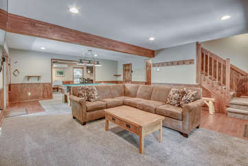 Sectional Couch and Coffee Table in Game Room