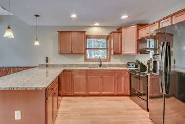 Luxury Kitchen with Fridge, Stove, and Expansive Counter Space