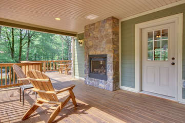 Outdoor fireplace on wrap around Porch