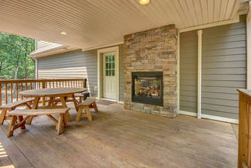 Covered Deck with Seating and Outdoor Fireplace