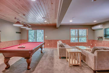 Game Room with Pool Table and Seating Area