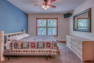 Bedroom with Bed, TV, Mirror and Ceiling Fan