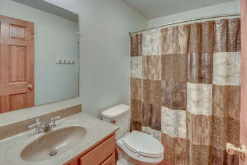 Bathroom with Curtained Shower, Toilet, and Sink