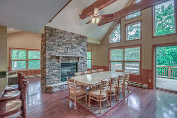 Dining Area with Adjacent Fireplace in our Vacation Rental Near Poconos