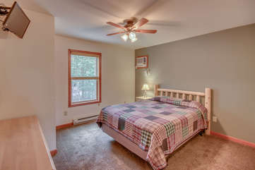 Bedroom with Warm Patterned Linens and Ceiling Fan