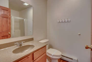 Cozy Bathroom with Toilet, Sink and Walk-In Shower