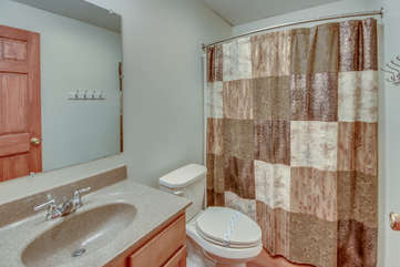 Bathroom with Toilet, Sink and Shower with Curtain