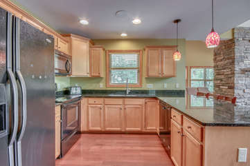 Kitchen with Fridge, Stove, and Dishwasher in our Poconos Vacation Rental