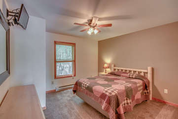 Bedroom with One Bed, Ceiling Fan and Mounted TV
