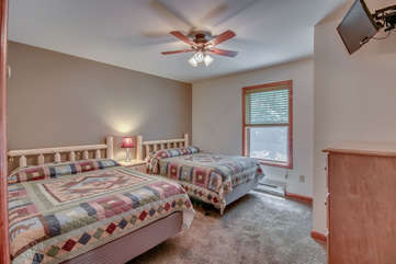 Bedroom with Two Beds, Mounted TV and Fan