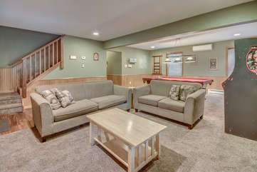 Two Couches in Game Room and One Coffee Table.