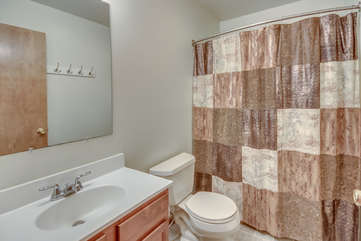 A Sink, Toilet, and Shower in the Bathroom.