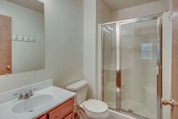 An Image of Bathroom with a Shower and Sink.