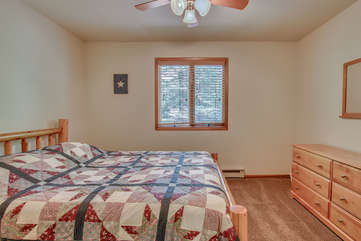 Picture of a bed and dresser in the bedroom of this Pocono rental in Towamensing Trail.