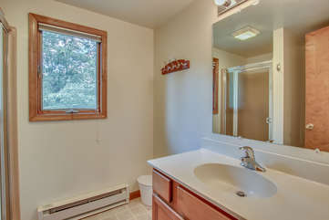 The sink and mirror in the bathroom of this Pocono rental in Towamensing Trails.