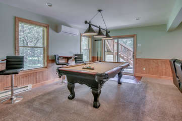 Game Room with Pool Table and Bar Stools