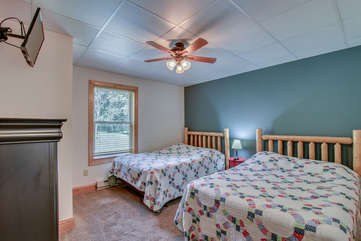 Bedroom with Two Beds, Mounted TV and Ceiling Fan