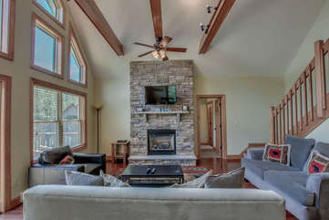 Seating Area with Fireplace and TV in our Pocono Mountain Vacation Rental